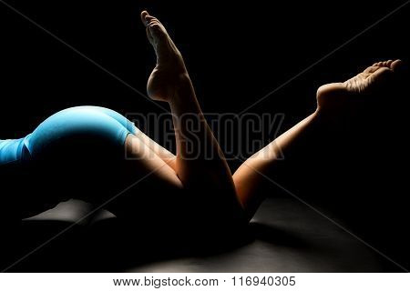Woman In Blue Shorts Lay Buttocks And Toes Up Highlighted