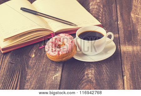 Coffee, Donut And Notepad On Wooden Background