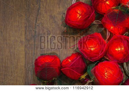 Red rose light on wood background