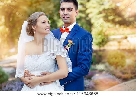 Marriage. Newlyweds outdoors. Posing bride and groom. Sunny day.