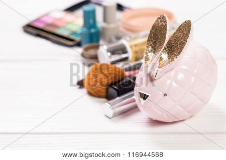 Various makeup products on dark background with copyspace