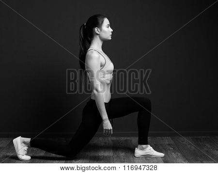 Exercise And Fitness - Sports Woman Doing Squat (lunge Forward)