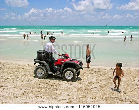 Policeman In Quad-biking, The Beaches Of Miami Patrol.