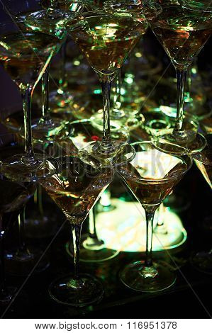 The champagne glasses are in a mysterious green light