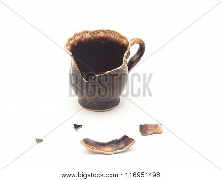 Broken Ceramic Cup On A White Background
