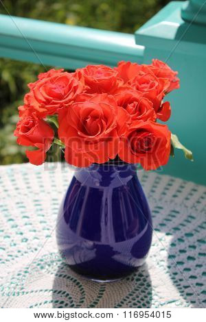 Bouquet Of Red Roses In A Vase On The Garden Terrace