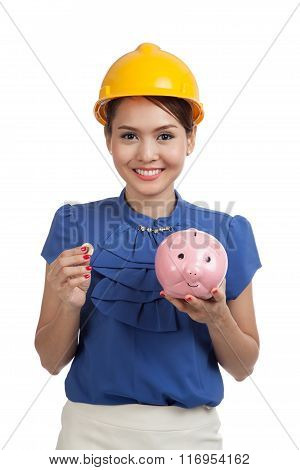 Asian Engineer Woman With A Coin And Piggy Coin Bank