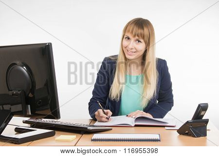 Business Woman Wrote In A Notebook And Looked Into The Frame