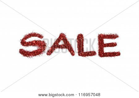 Word Sale of red glitter sparkle on white background