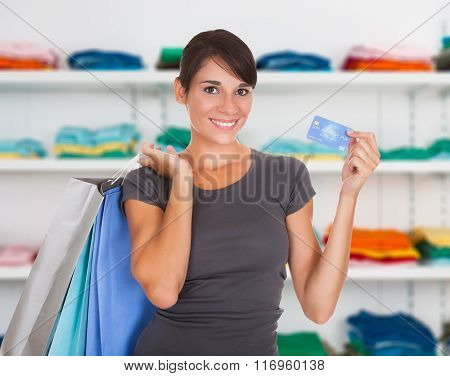 Woman With Shopping Bag And Card