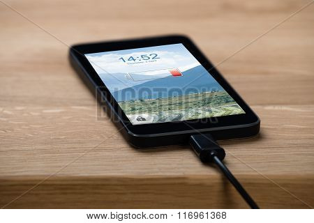 Closeup Of Smart Phone Connected To Charger