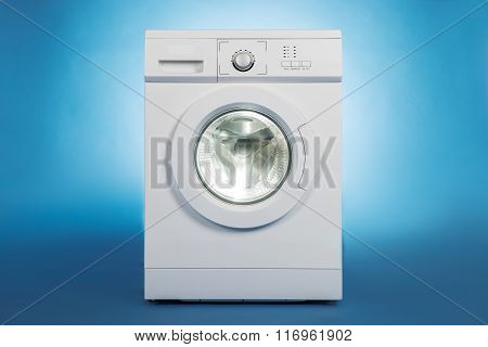 Washing Machine Over Blue Background
