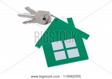 Closeup Of Green Paper House And Keys