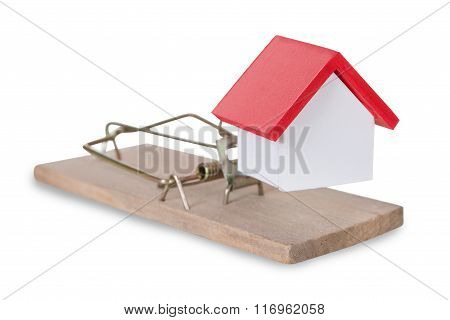 Closeup Of House Miniature On Mousetrap