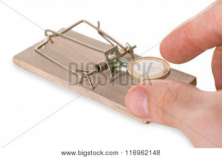 Hand Reaching Coin On Mousetrap