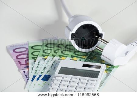 Calculator With Electric Plug With Euro Banknotes