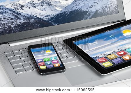 Digital Tablet And Smartphones On Laptop