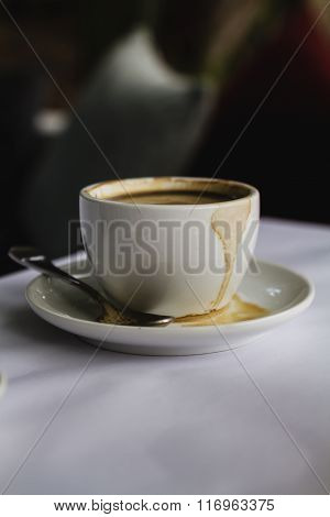 Close Up Of White Coffee Cup Espresso Spilt On Saucer