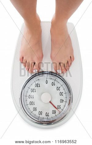 Directly Above Shot Of Woman Standing On Weight Scale