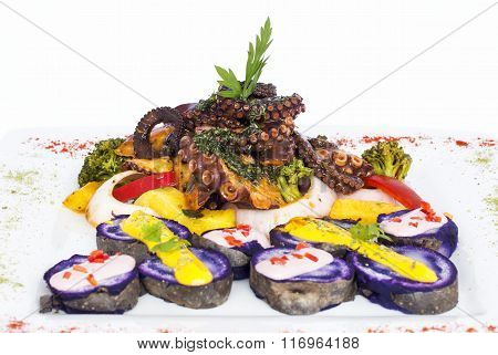 Grilled Octopus, gourmet dish from Peru. Served with purple potatoes (nativa).