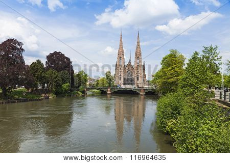 Picturesque View Of St. Paul Church And Ill River In Strasbourg, France