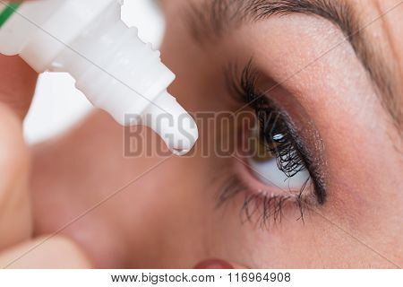 Close-up Of Person Pouring Drops In Eyes