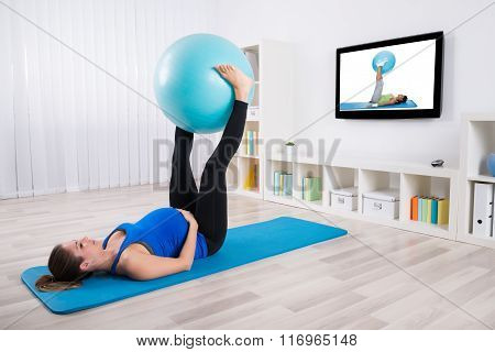 Pregnant Female Exercising With Fitness Ball