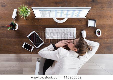 Businesswoman Sleeping At Desk