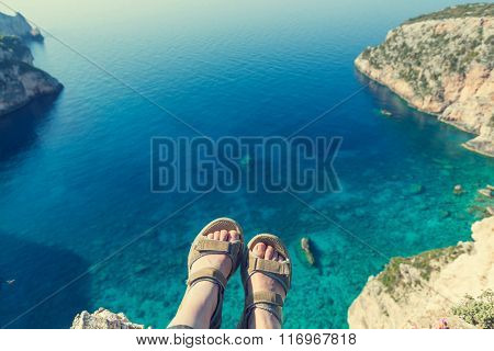 Feet above the sea bay