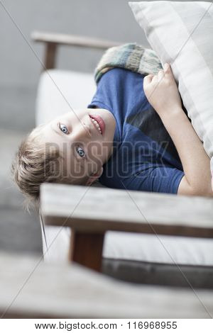 Lazy funny little child lying on sofa