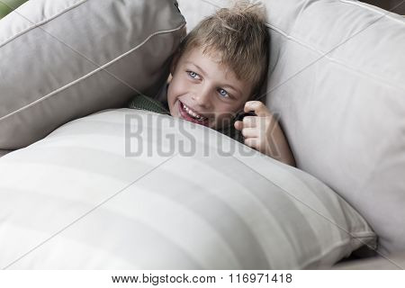 happy boy laying on couch at home