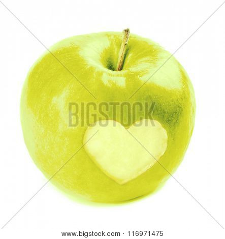 Green apple with heart isolated on white
