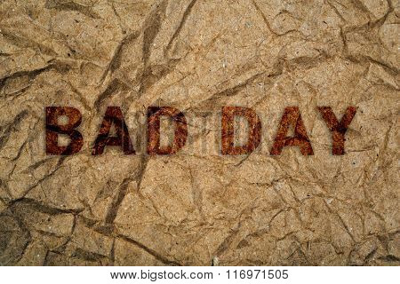 Crumpled paper with text Bad Day