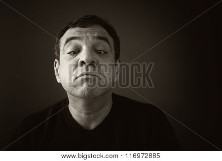 Man grimaces. Black and white photo