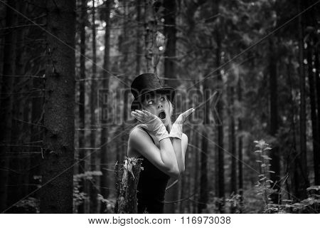 Portrait of young beautiful woman in the forest