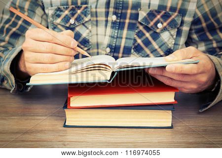 Man working with books, close up