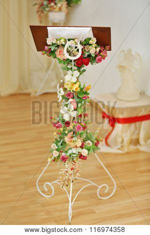 Wedding desk decorated with garland of flowers