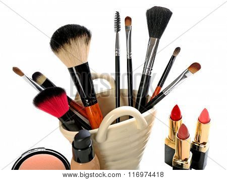 Cosmetics set on light wooden background