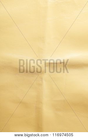 Beige leather texture with crumpled uneven surface