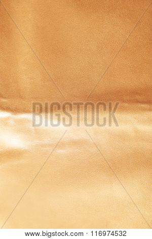 Pink leather texture with crumpled uneven surface
