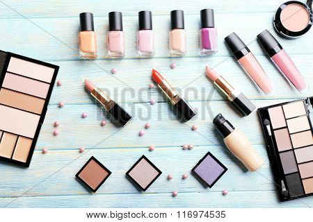 Cosmetics set on blue wooden background