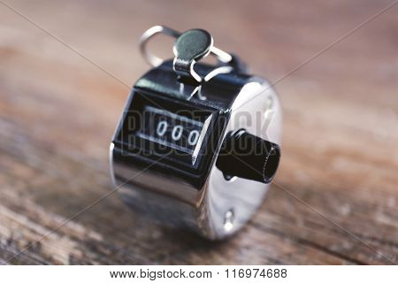 Stopwatch on wooden background, close up