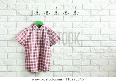 Male clothes on hangers in a room