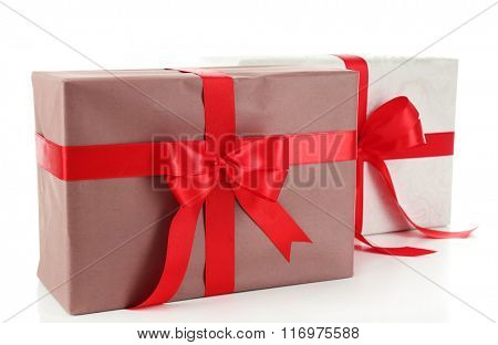 Beautiful gifts with bows isolated on white