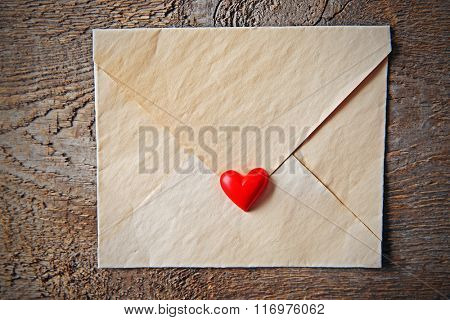 Blank present Valentine envelope on wooden background