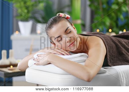 Young woman ready for spa massage at beauty spa