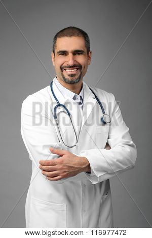 Portrait of a doctor on grey background