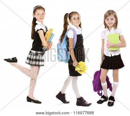Cute happy schoolgirls, isolated on white