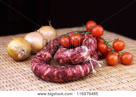 Smoked Sausage With Onions And A Bunch Of Small Red Tomatoes