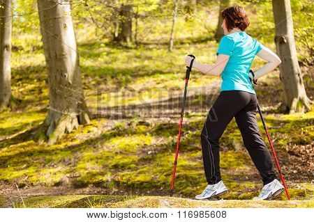Nordic Walking. Woman Hiking In The Forest Park.